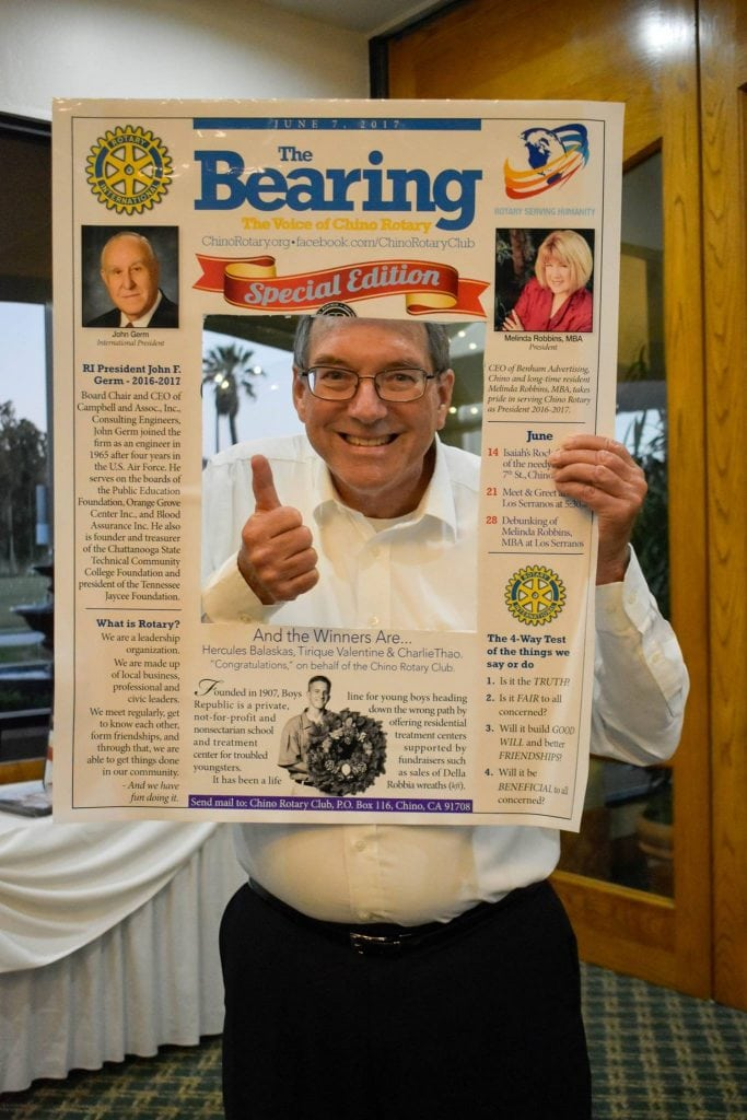 Jeff Werner Poses with a Rotary Newsletter Prop